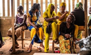 Women practise hairdressing in the Democratic Republic of the Congo