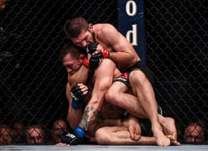 Nurmagomedov submits McGregor by rear-naked choke in round four.