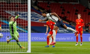 Dominic Calvert-Lewin powers a header past Wales's Wayne Hennessey for a goal on his England debut