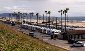 Rows of recreational vehicles sit in Dockweiler beach RV park. They can be used to temporarily house individuals affected by the coronavirus who are unable to self-isolate.