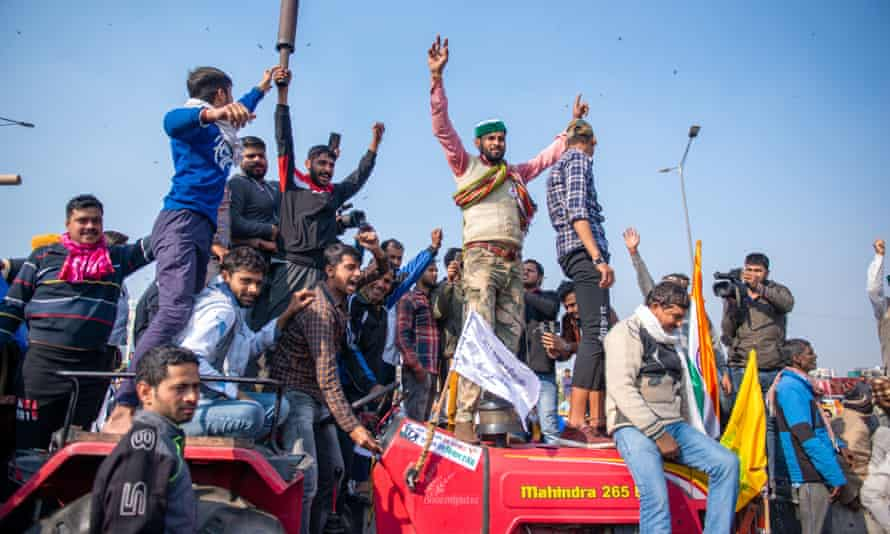 Farmers use a tractor to block a main road in Ghaziabad