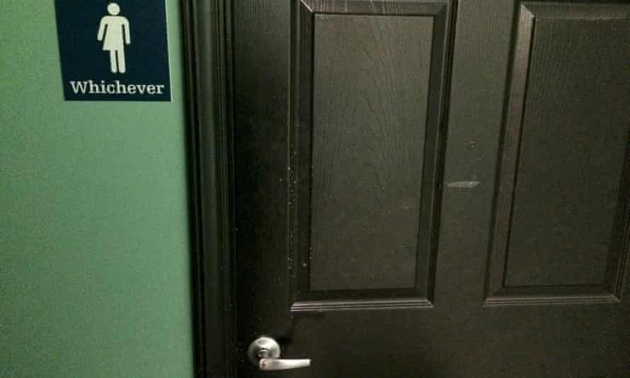 A bathroom sign welcomes both genders at a restaurant in Durham, North Carolina May 5, 2016.