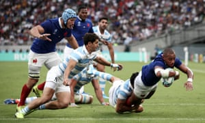 Gael Fickou dives to score France's first try against Argentina in their thrilling opener at Tokyo Stadium.