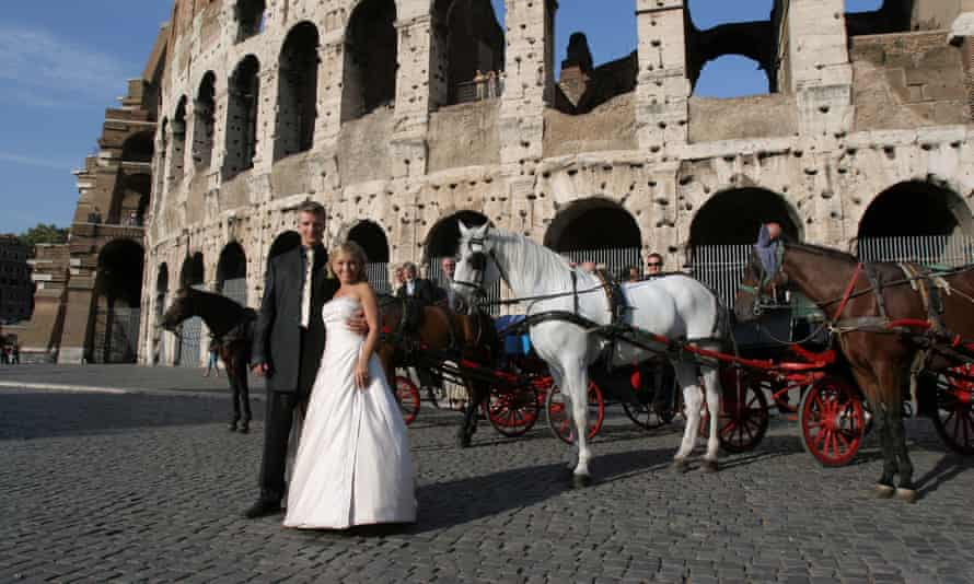 A bride and groom at the Colosseum in Rome