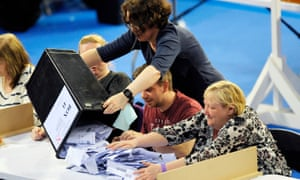 Staff members empty a ballot box in Glasgow during the Brexit referendum