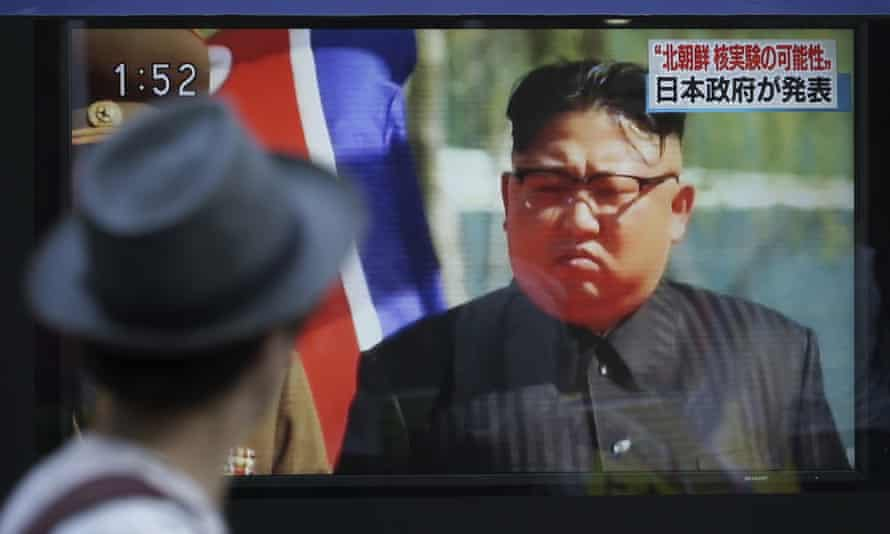 Kim Jong-un on an oudoor video screen showing a Japanese news broadcast.