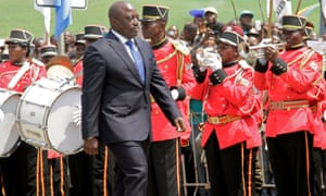DRC president Joseph Kabila inspects a guard of honour during the anniversary celebrations of Congo's independence from Belgium.