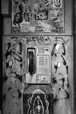 A vandalised phone box in Camden, near the market stalls under the railway bridge