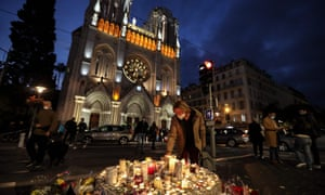 Candles are lit outside the Notre-Dame de l'Assomption Basilica in Nice on 30 October in memory of the three people murdered there the day before.