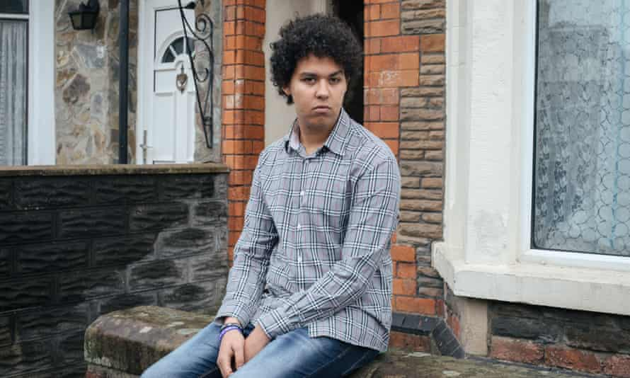 Abderrahim sits outside his house in Cardiff