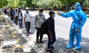 People in need of food assistance get their temperatures checked in New Delhi on 30 May 2020 as India reported as a record daily rise in Covid-19 infections.