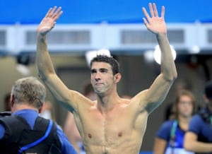 Michael Phelps waves to the crowd at the end of potentially his final race.
