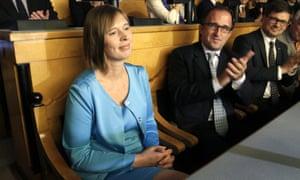 Kersti Kaljulaid is applauded by Estonian parliamentarians in Tallinn.