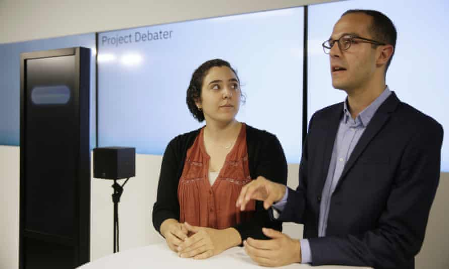 Noa Ovadia, left, and Dan Zafrir, right, prepare for their debate against the IBM Project Debater.