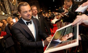 Leonardo DiCaprio signs autographs on the red carpet
