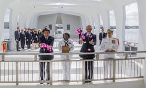Shinzo Abe and Barack Obama toss flower petals into the Wishing Well at the USS Arizona Memorial.