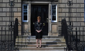 Scotland's First Minister Nicola Sturgeon observes a minute's silence outside Bute House on April 17, 2021 in Edinburgh, United Kingdom.