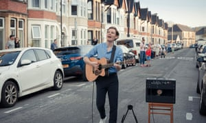 Singer-songwriter Al Lewis with his guitar and amp in the middle of Northumberland Street, Cardiff