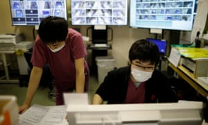 Medical workers wear protective face masks as they work at the Intensive Care Unit (ICU) ward for coronavirus disease (COVID-19) patients at St. Marianna Medical University Hospital in Kawasaki, south of Tokyo, Japan May 4, 2020. REUTERS/Issei Kato