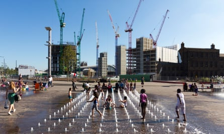 Children play in fountains during a heatwave in Kings Cross, London