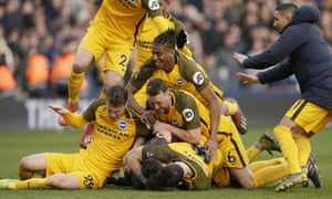 Brighton players celebrate winning in the penalty shootout – their manager Chris Hughton will have felt the match should have got that far.