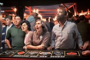 Jackpot, 1961. Fred Herzog was an under-recognized early practitioner of colour street photography. Here he captures the charged moment of anticipation when carnival contestants are all transfixed as they await a game's results. Will they luck out?