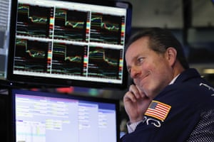 Specialist Glenn Carell works at his post on the floor of the New York Stock Exchange today