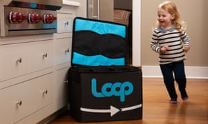 A child passes a Loop container