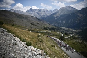 The pack rides in the eighteenth stage of the 106th Tour de France between Embrun and Valloire.