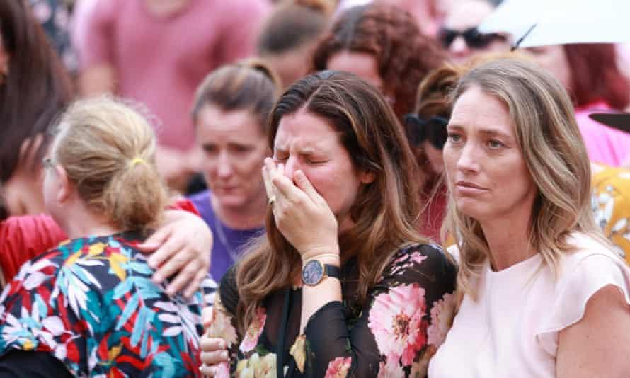 woman cries at vigil for Hannah Clarke