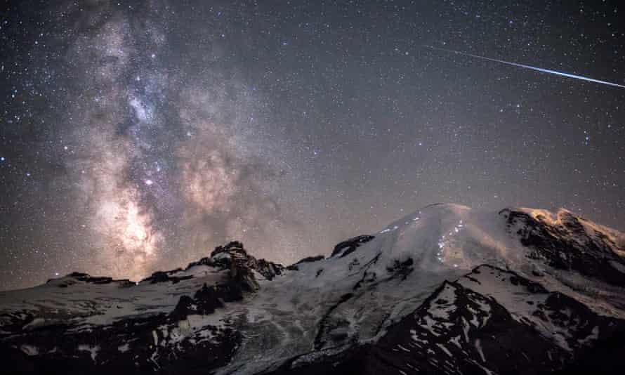 The Milky Way towers above the 4,392m peak of Mount Rainier in Washington, USA