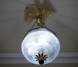 Another eagle statue perched on top of a chandelier in the Oval Office