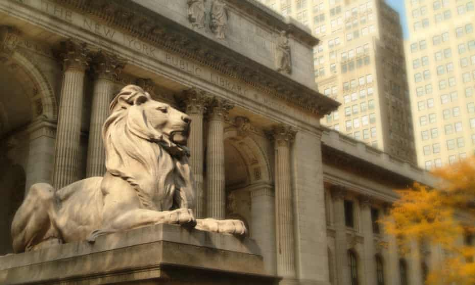 one of New York Public Library's lion statuesoutside the Stephen A Schwarzman building on Fifth Avenue.