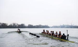 The Cambridge crew, left, pull ahead.