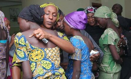 Oludolapo Osinbajo (second from left), wife of Nigerian vice-president Yemi Osinbajo, consoles one of the 21 released Chibok girls in October 2016.