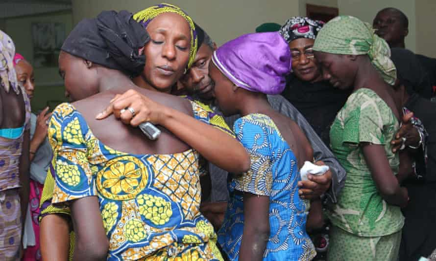 The wife of the vice-president of Nigeria, Dolapo Osinbajo, consoles one of the 21 released Chibok girls in October 2016.