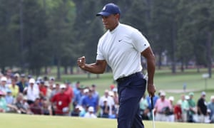 Tiger Woods fist-pumps as he birdies the ninth. The four-times Masters champion is on the charge.