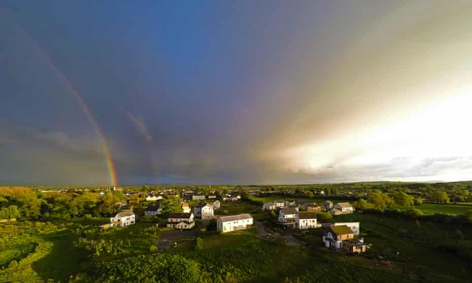 A rainbow appears over the Cloughjordan eco-village in Tipperary, Ireland.