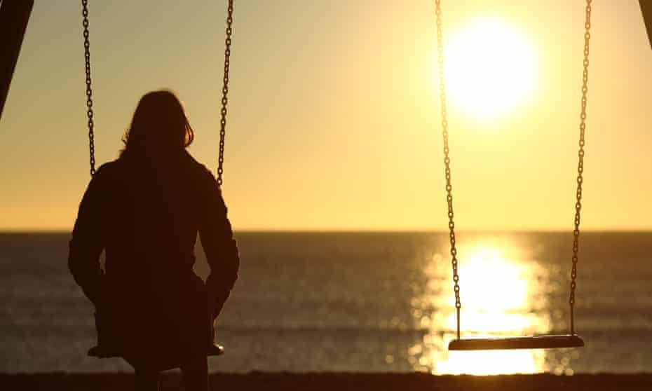 Woman watching sunset alone