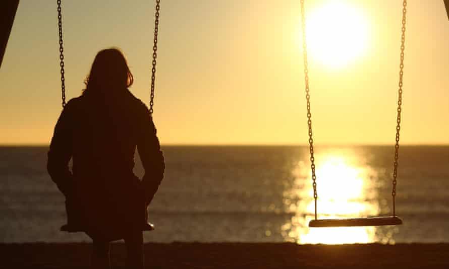 Woman watching sunset alone.