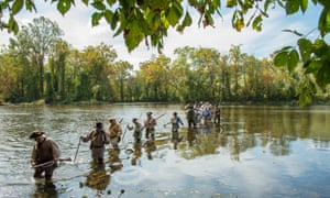 re-enactors cross the Watauga River in Sycamore Shoals State Park, near Elizabethton, Tennessee