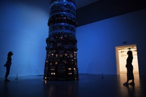 London, UK: masked gallery workers pose by the work Babel by artist Cildo Meireles during a media preview of the reopening of the Tate Modern