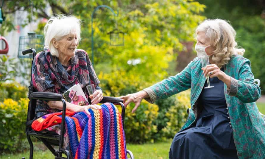 A woman visiting her 100-year-old mother at a care home last July