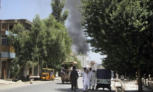 Smoke rises from a building in Jalalabad, Afghanistan, after gunmen attacked and took hostages.