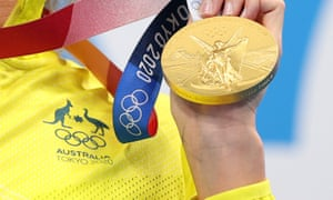 Australian swimmer Emma McKeon with one of the gold medals she has won at the Tokyo Olympic Games.