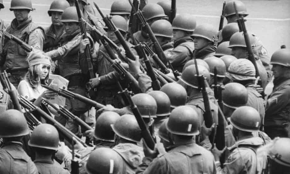 National guard troops confront a protester at Peoples Park in Berkeley, 1969.