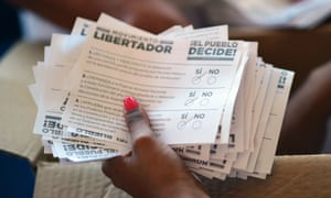Volunteers count the ballots during an opposition-organized vote to measure public support for Venezuelan President Nicolas Maduro.