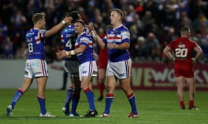 Wakefield Trinity players celebrate at full time after their victory over London Broncos.