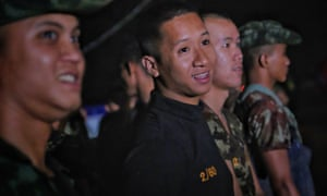 Military personnel, rescue workers and volunteers head out from Tham Luang Nang Non cave after ambulances transported a group of boys rescued from the cave.