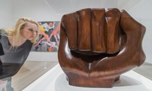 A woman looks at the sculpture Black Unity 1968, by Elizabeth Catlett, in the Soul of a Nation exhibition.